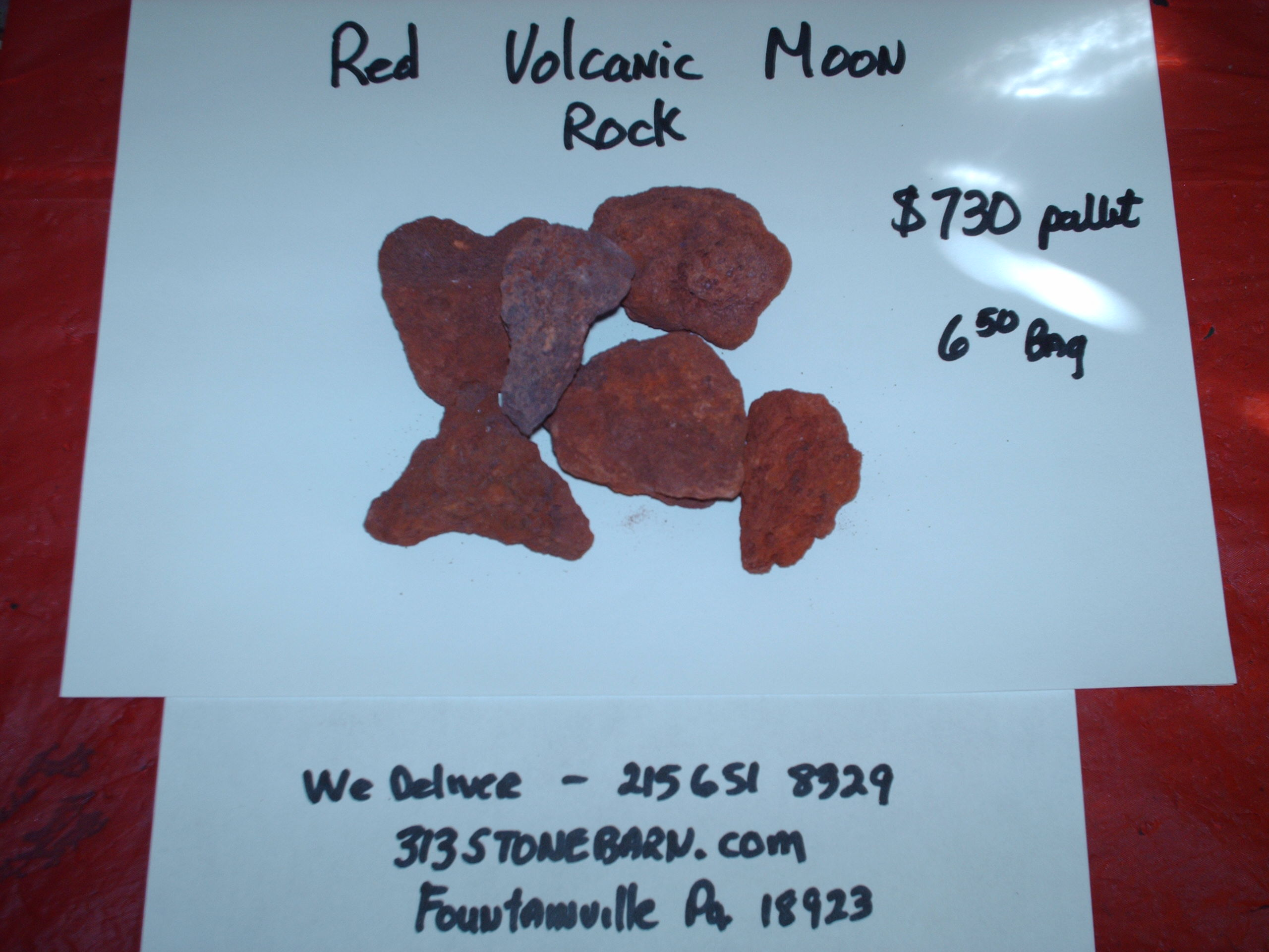 We deliver pallets of these Red Volcanic Moon Rocks.